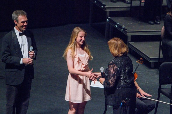 Natalie Sherman Jollis receives congratulations and check from Voices conductor Dr. Sue Klausmeyer and Voices member John Paul Middlesworth